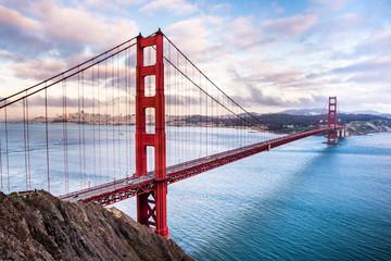 Fotobehang San Francisco Panoramic view of Golden Gate Bridge connecting San Francisco and Marin Headlands, at sunset