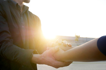 Woman and man holding hands to take care and help each other.