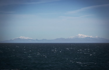 Background image of New Zealand snow capped mountains viewed from the Cook Strait.