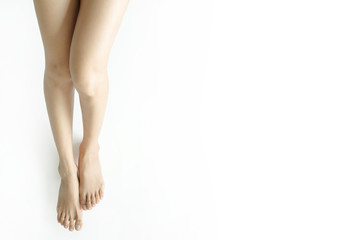 Beautiful perfect woman legs and feet on a white background.Concept beauty and hydration of the skin.