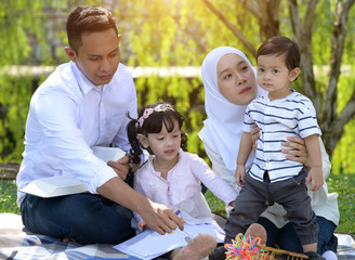 malay family enjoying quality time at the park