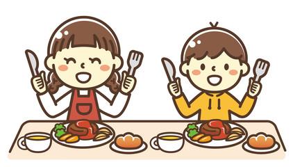 ハンバーグを食べる子供
