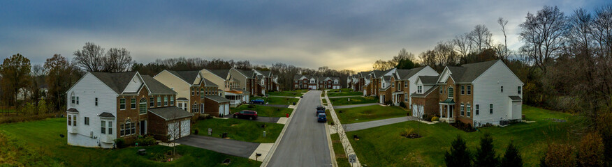 Aerial panorama of a row of newly constructed two story single family homes in a new construction middle class neighborhood street in the USA - American real estate Wall mural