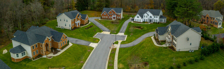 Aerial panorama of upper middle class single family homes neighborhood street American real estate in a new construction in Maryland USA