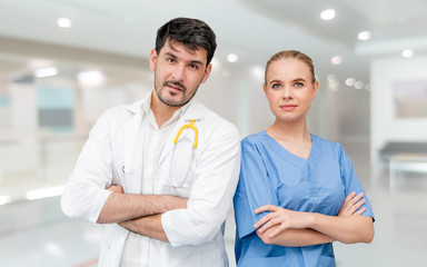 Doctors at hospital office working with another doctor. Healthcare and medical services.