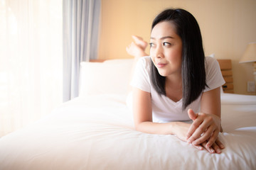 Woman relax on her bed.