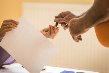Person receives the stamp at a polling station