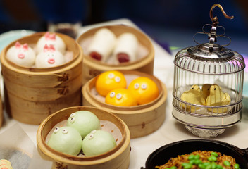 Dim sum in bamboo steamer, animal theme for kids