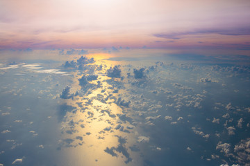 Ocean at sunset or sunrise, view from airplane