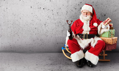 Santa Claus, sled and presents with copy space
