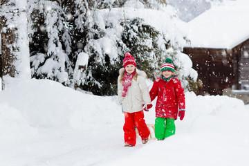 Kids play in snow. Winter sleigh ride for children