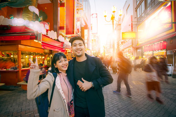 asian woman and men in dotonbori osaka one of most popular traveling destination