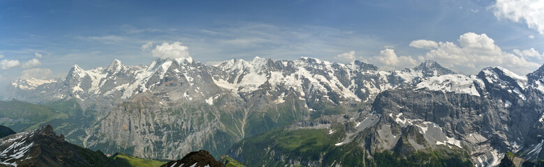 Wall Mural - Typical Bernese Highlands panorama with dominant Jungfrau, Monch and Eiger peaks