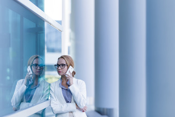 Portrait of beautiful business woman talking on the smartphone outdoor