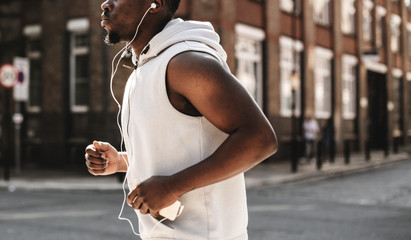 Athletic man running with earphones