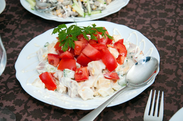 Salad with mayonnaise, tomato, cucumber and green vegetables. Holiday Christmas, birthday