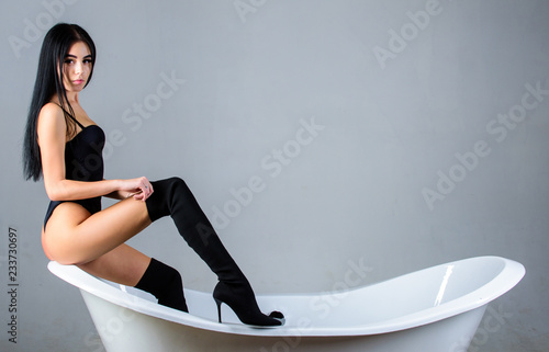 e969d431f9 Confidence to seduce concept. Enjoy being sexy woman. Girl relaxed sexy  pose sit on bathtub. Erotic and desire. Fashion sexy model seductive posing  on ...