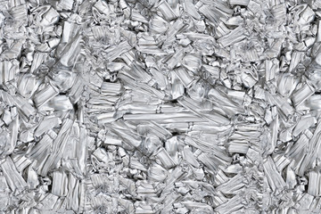 pressed aluminum scrap background and texture, silver metal recycling.