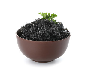 Bowl with delicious black caviar on white background