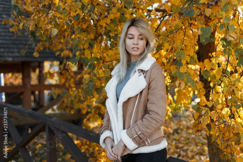 132009328 Cute attractive young girl blonde in stylish clothes walks in the ...