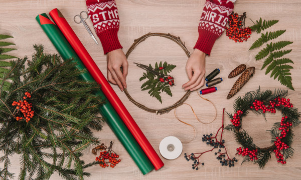 hands on wooden table with christmas decoration