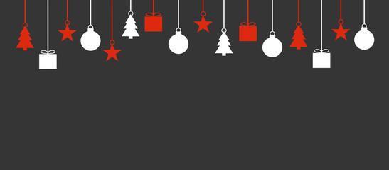Grauer Hintergrund mit schlichter weiß roter Weihnachtsdekoration