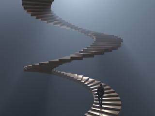 Photo sur Plexiglas Spirale man climbs the spiral staircase