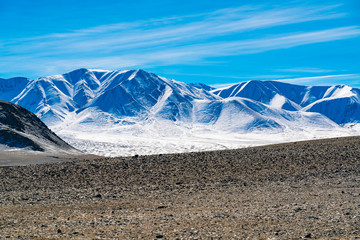 Scenic view of snow covered mountain in summer near Ulgii in Mongolia