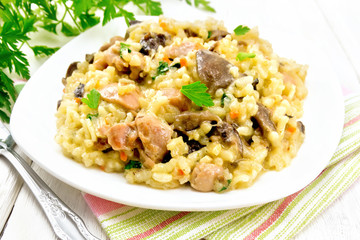 Risotto with mushrooms and chicken on table