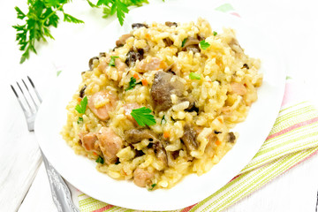 Risotto with mushrooms and chicken on light board