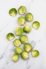 Poster Brussels Fresh raw brussel sprouts on a marble background