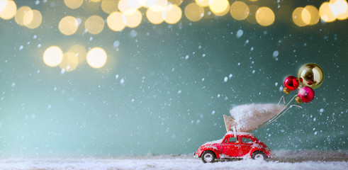 Christmas invitation card background;  Christmas tree on toy car, Christmas gift and holidays ornament;