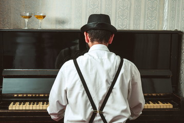 Retro man playing the piano