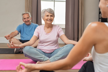 Old couple sitting in lotus position