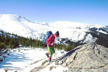 Winter hiking in the mountains with snowshoes.