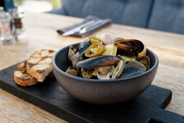 Clams and mussels stew with grilled bread
