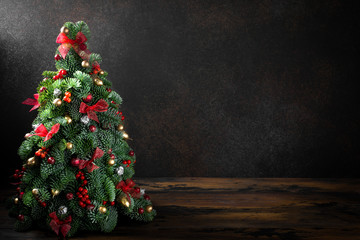 Christmas tree on a brown background with copy space. Image for cards, invitation, prints, posters.