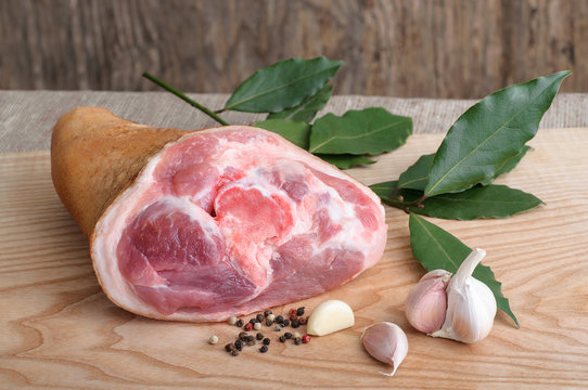 Raw pork knuckle with pepper. garlic and bay leaves