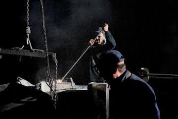 An operator cleans the furnace at Mugarri Fundiciones foundry in Manaria