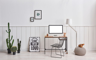 White wall classic room desktop screen and table with lamp.