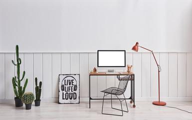 Working room desktop screen orange lamp and chair interior.