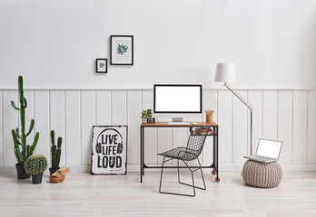 Decorative working room with computer frame and lamp decoration.