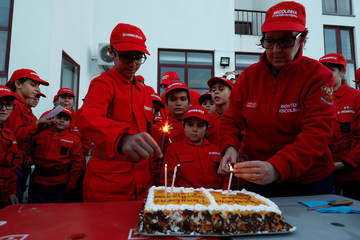 Members of firefighter school celebrate the birthday of two people after a training session in Oliveira do Hospital
