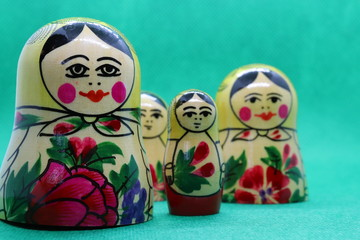 Four Russian dolls against green backtround