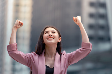 Young pretty woman raised hands up celebrate success in job or great news, I can do it.