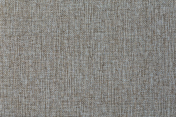 The texture of gray fabric textile upholstery of furniture.