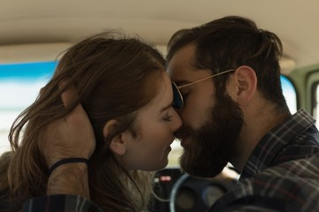 Couple kissing in vehicle on roadtrip