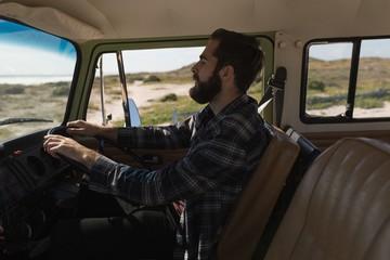 Man driving car during roadtrip