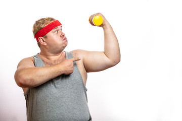 Ironic funny picture of obese corpulent man shows muscles and strength, screaming from physical effort, while lifting little dumbbell in one hand, isolated shot over white background with copyspace