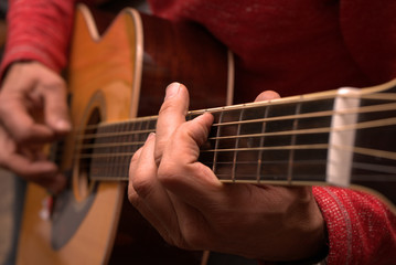 in hands acoustic guitar